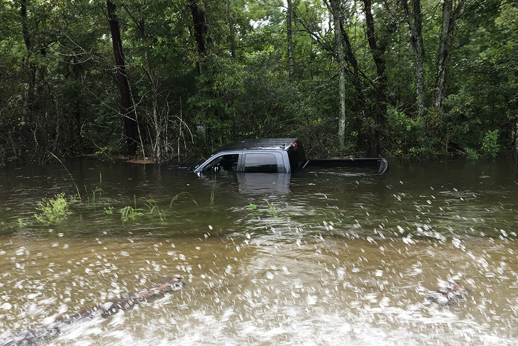 an abandoned truck in flood water