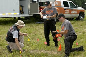 ASPCA Animal Forensic Sciences Team members at work in a field.