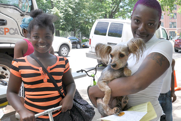 Latrece Brown (pictured here with her daughter) brought Lucky, their 6-year-old Yorkie