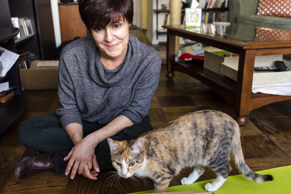 ASPCA volunteer with newly adopted cat