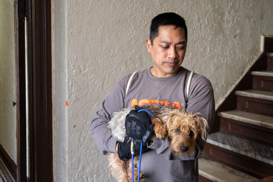 ASPCA responder carrying rescued dog