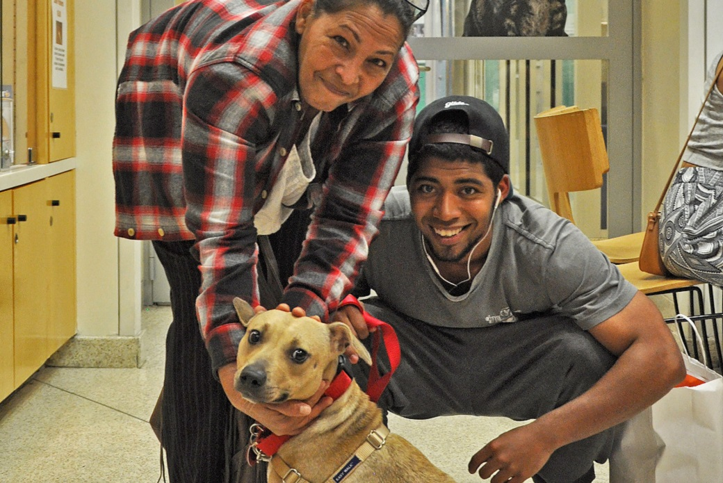 Valentine and her adopters, Julio Pena and Ibelisse Castillo