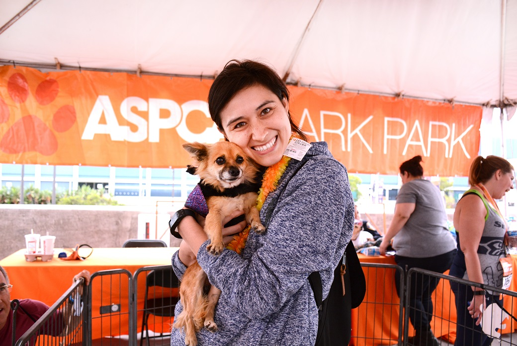 Team ASPCA member with dog