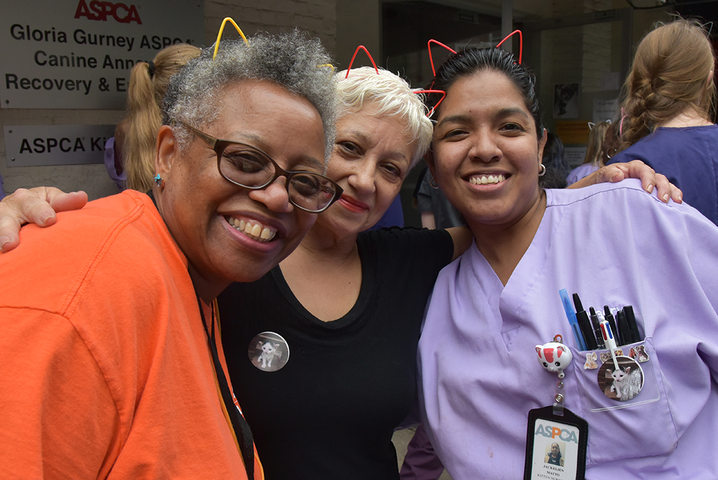 Volunteer Marcia Perdue-Charles with caregivers Iris Lugo and Jackelein Matto