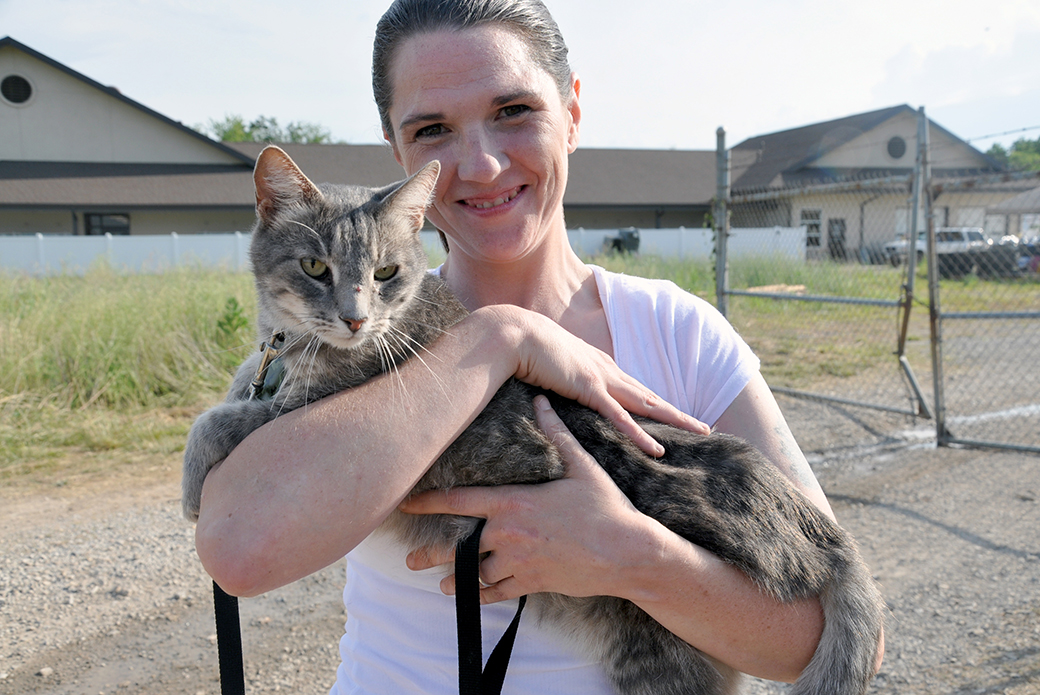 Janyce Prier after reclaiming her cat, Gus, who was lost in the tornado.