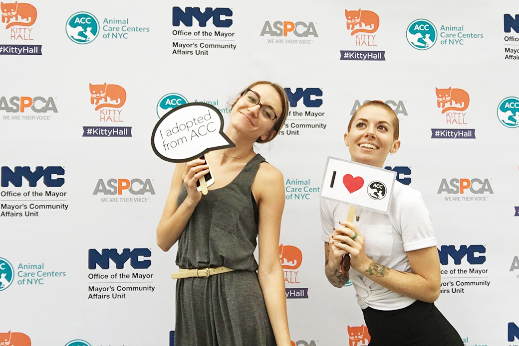ASPCA staff holding ACC signs