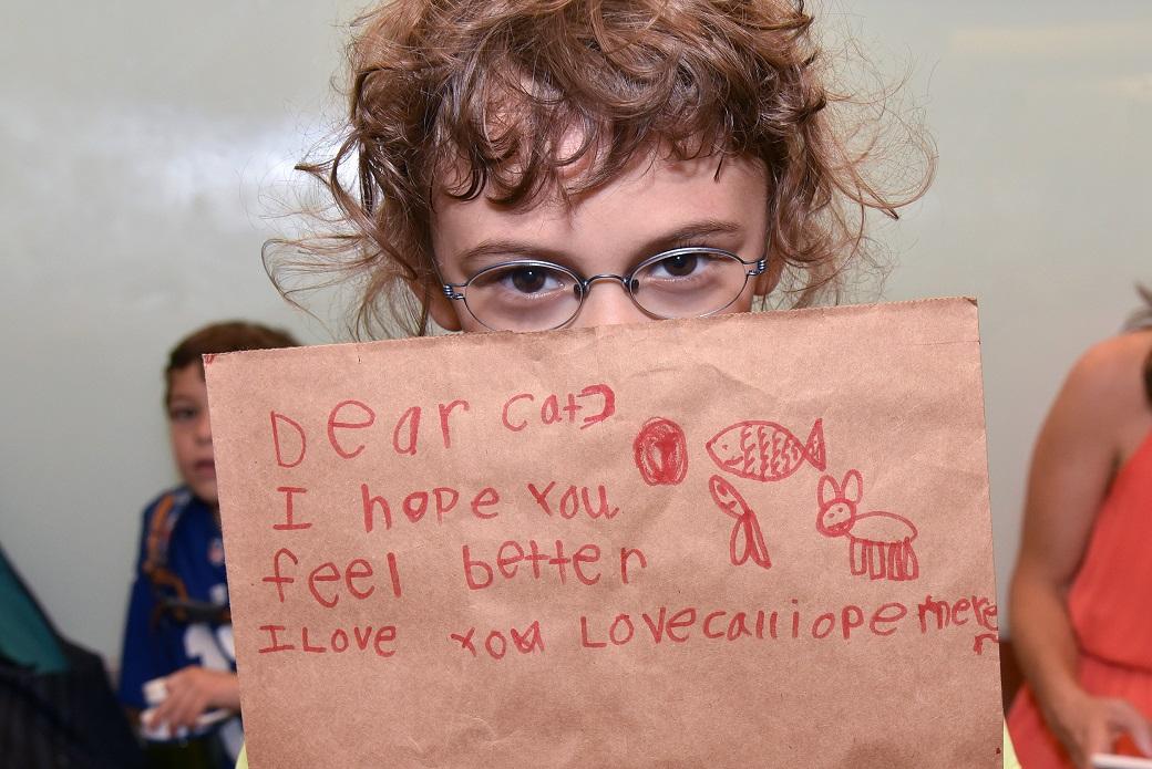 Callie Meyer shows her cat bag.