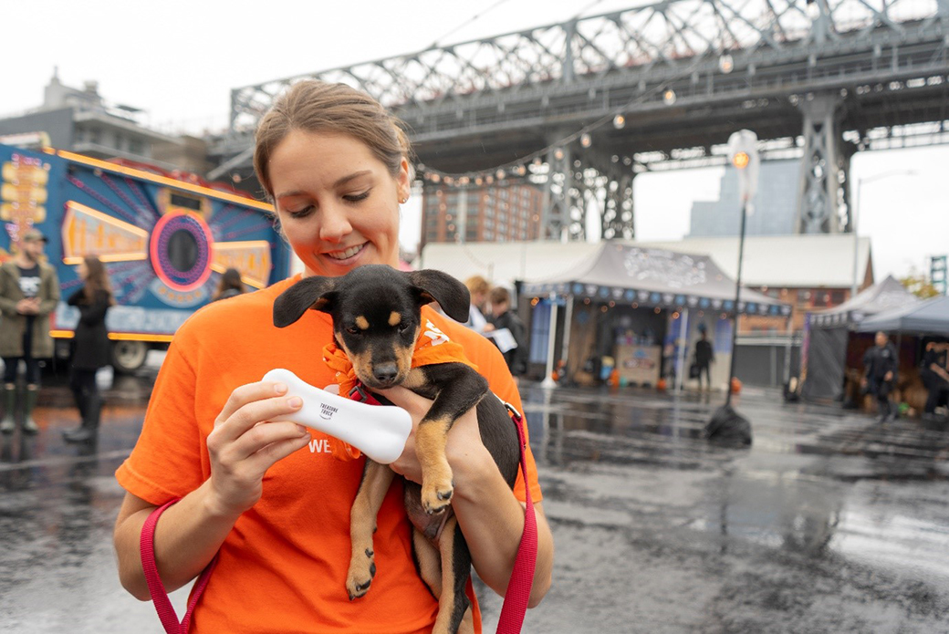 ASPCA employee with a puppy