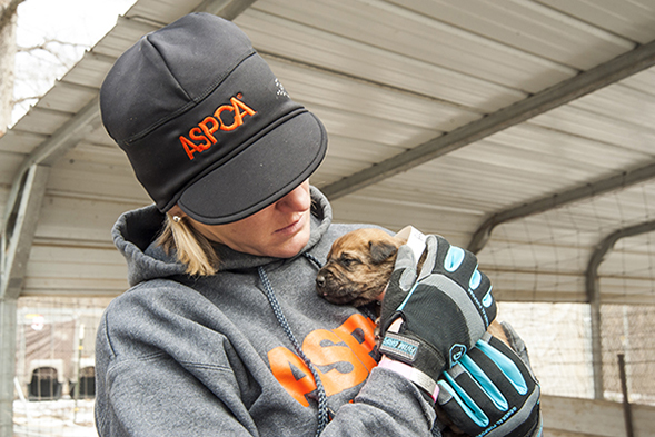 Gina Manke, FIR Responder, holding puppy from puppy mill
