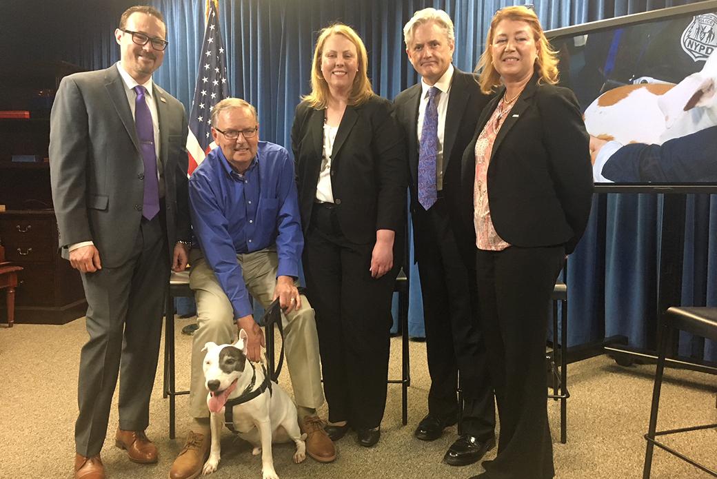 Tim Ferguson (FBI), McFly and his pet parent, Mike Burgess, Ann Coffey (USDA), Joe Poux (DOJ/ENRD) with the ASPCA's Nancy Perry