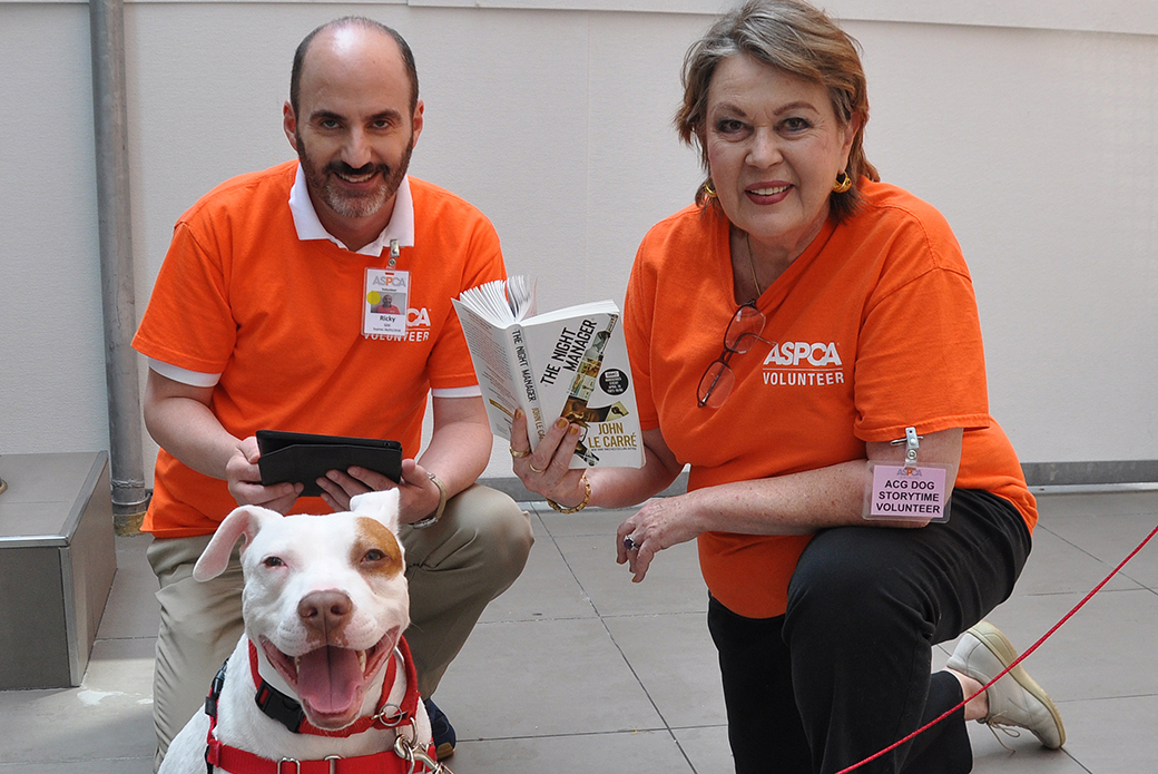 Two volunteers with dog
