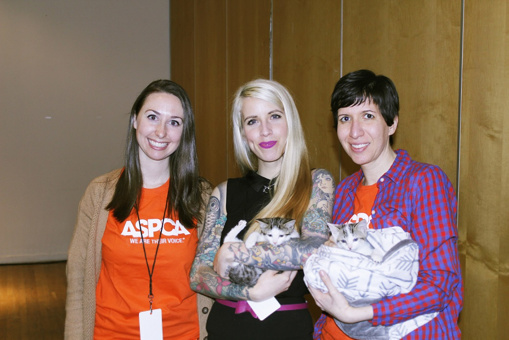 ASPCA volunteer with a kitten