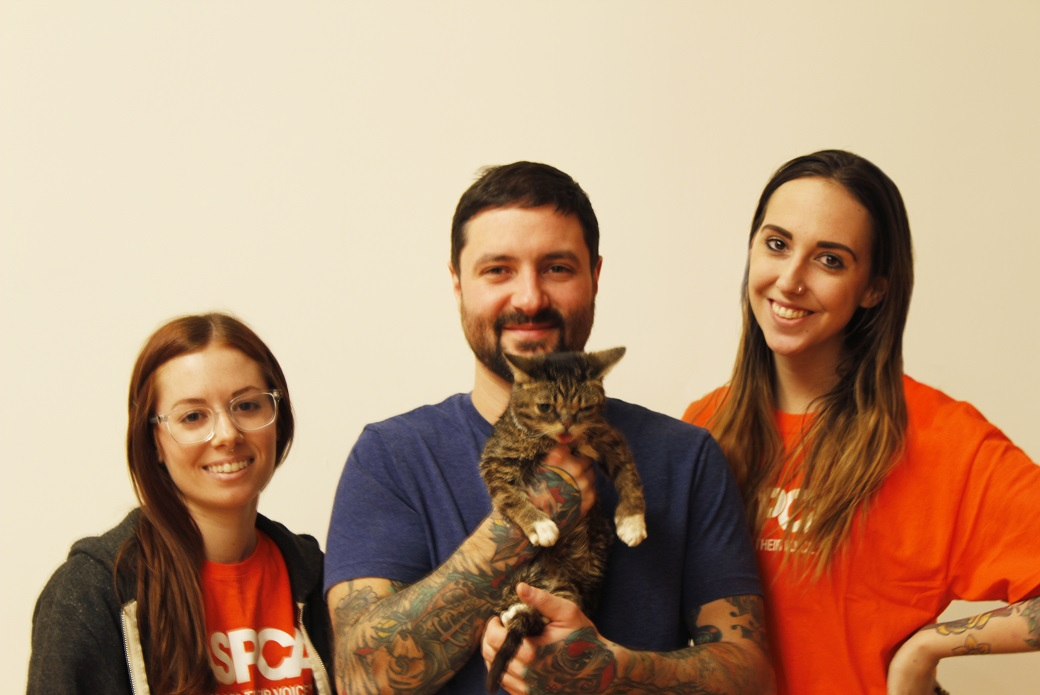Lil BUB poses with ASPCA staffers and her pet parent, Mike Bridavsky.