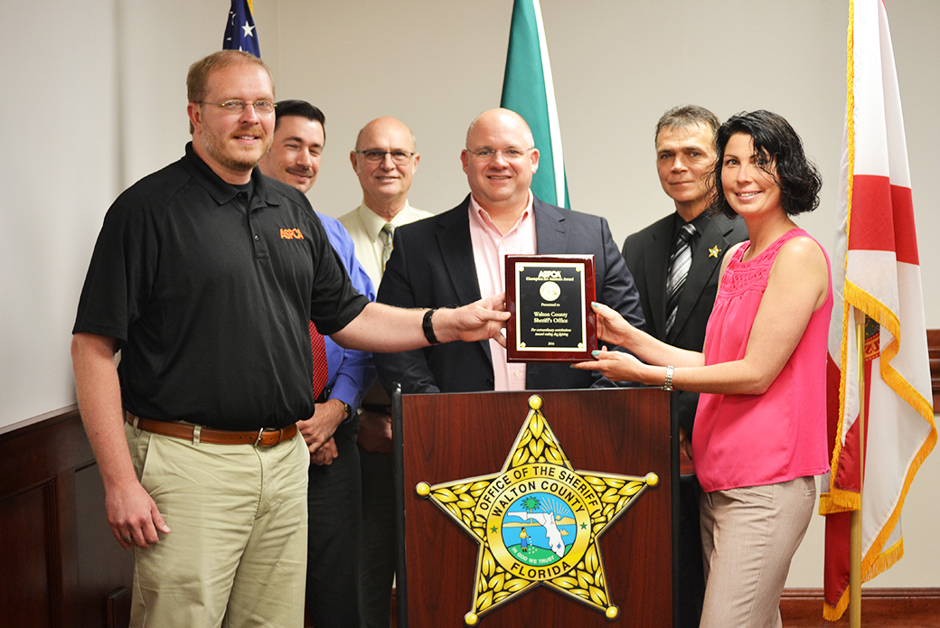 Recipients from Walton County, Florida, receive their award.