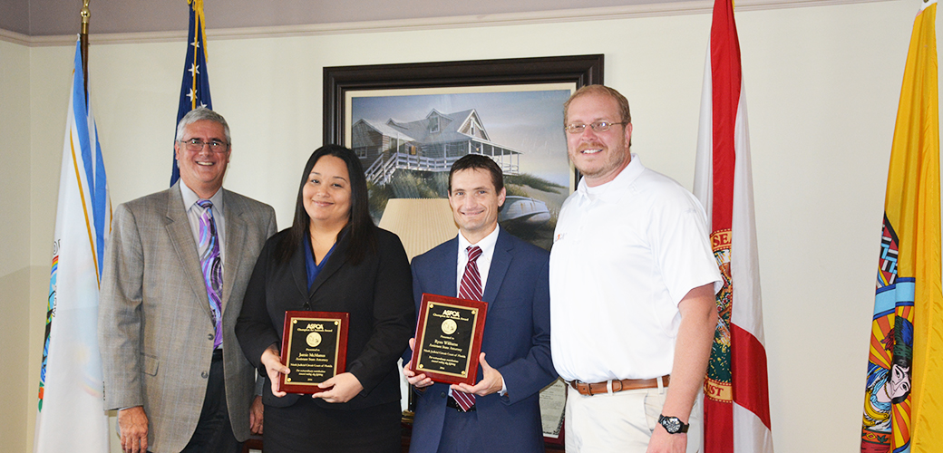 "Florida assistant state attorneys Jamie McManus and Ryan Williams receive their ""Champion For Animals"" award.]"