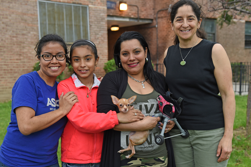 Giselle Pescador (left) and Dr. Lori Bierbrier (right) pose with Chispi, Sasha and Elizabeth.
