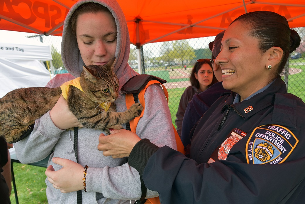NYPD Traffic Officer Carmen Pena, right, with Sarah Ritchie and her cat, Marty.