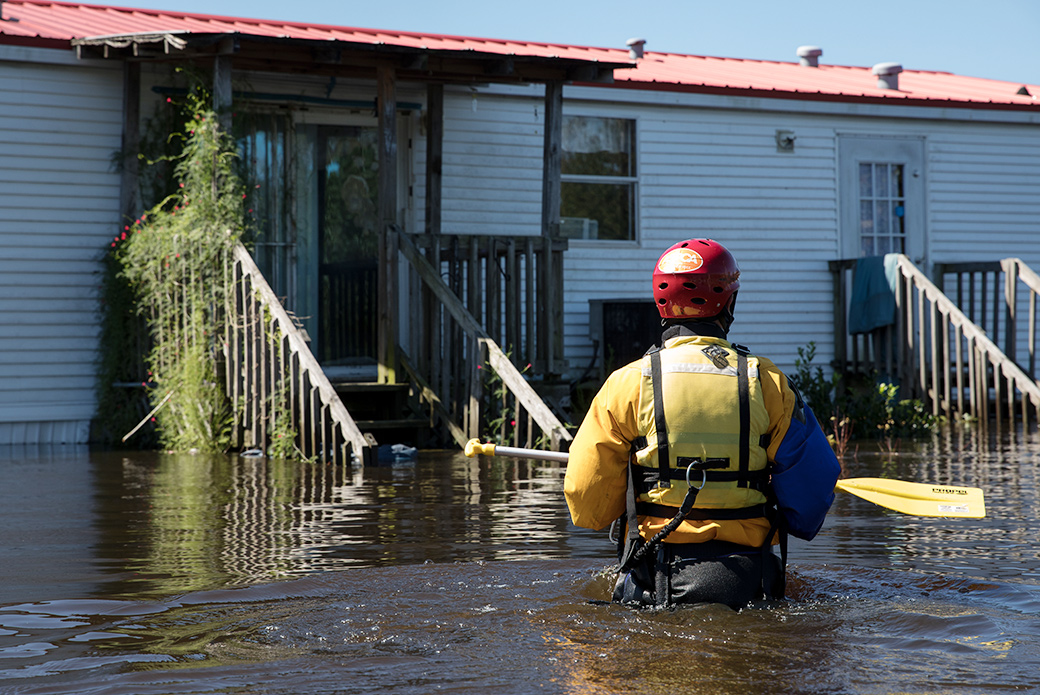 our responder wading through flood water