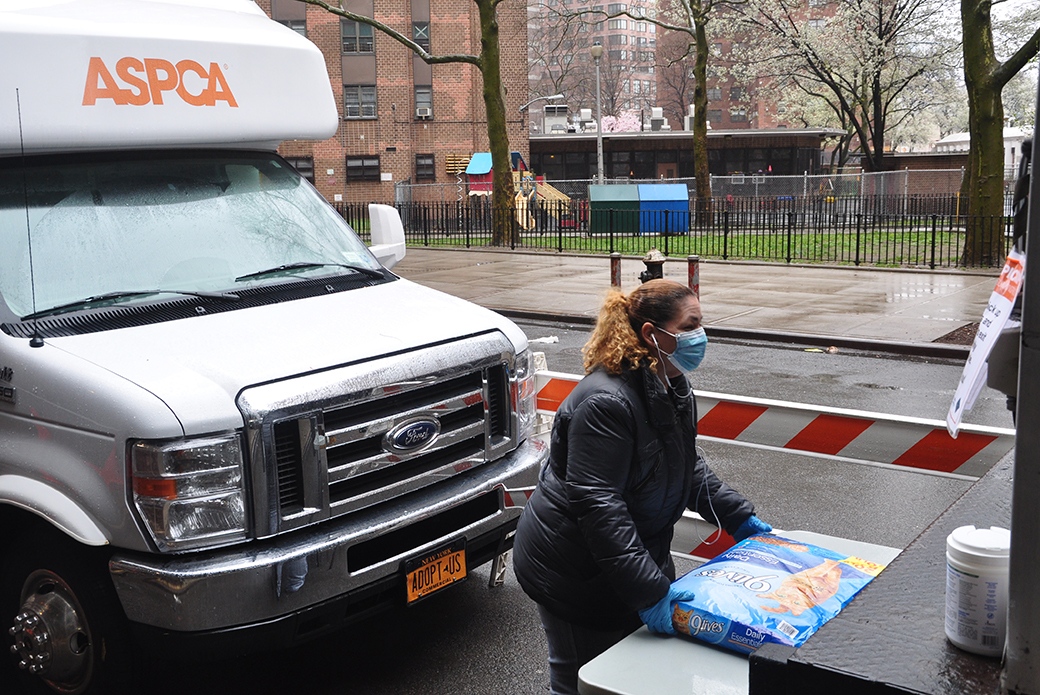 ASPCA Staff member moving a bag of pet food