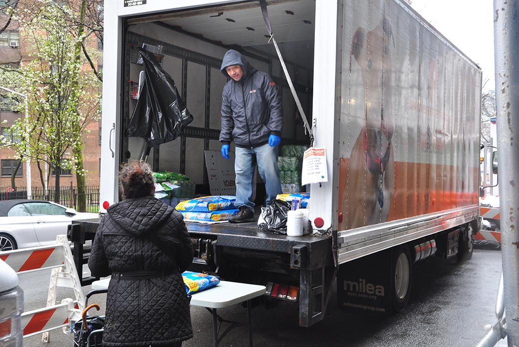 ASPCA staff moving pet food bags