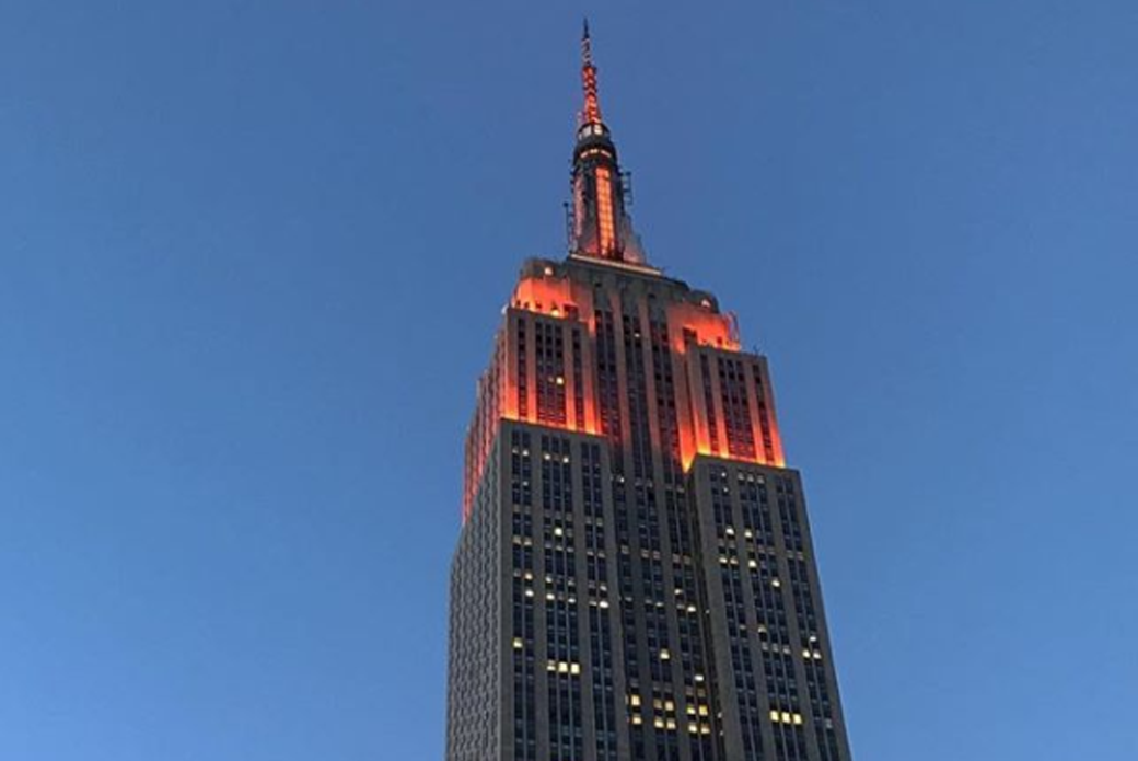 The Empire State Building lit orange