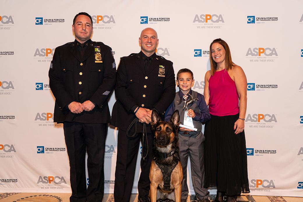 Brady Snakovsky with two police officers and a police dog
