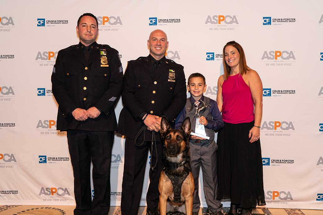 Brady with his mother, two police officers, and a police dog