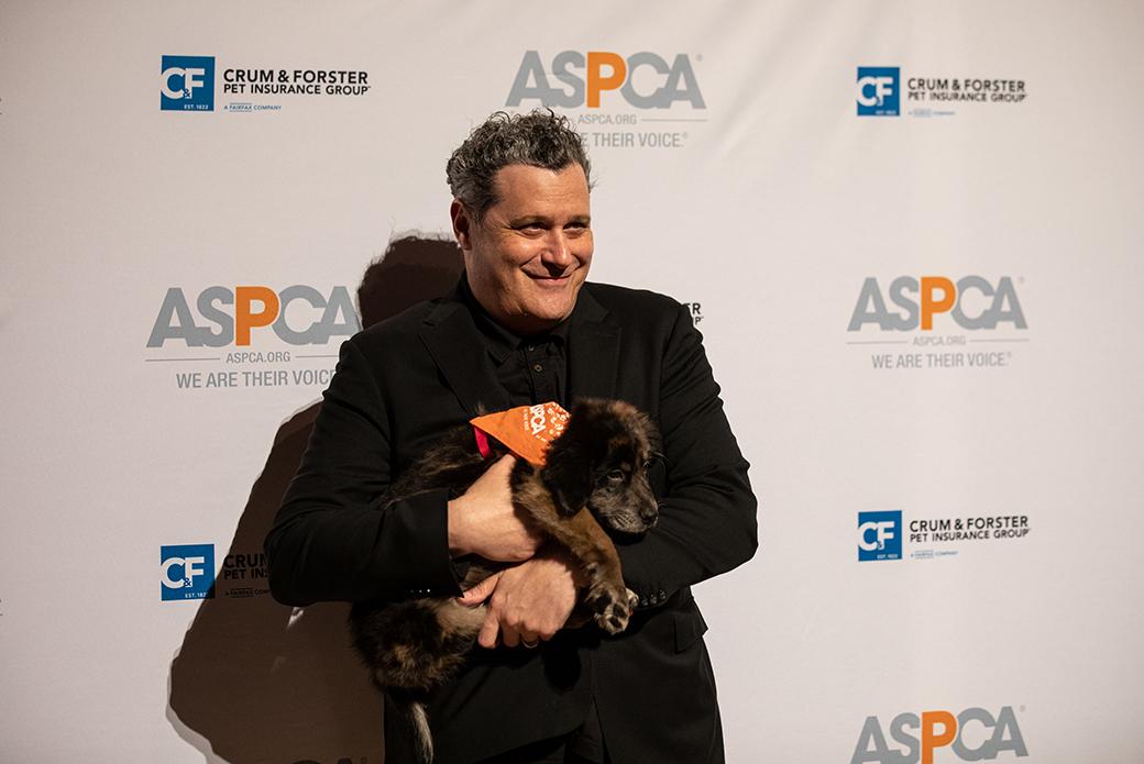 Isaac Mizrahi holding a puppy