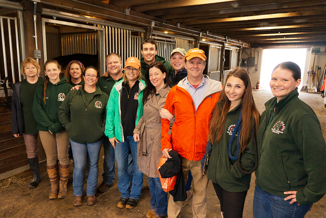 Gentle Giants staff and volunteers with Nancy Perry, Huw Collins, and ASPCA VP of Federal Affairs Richard Patch (orange jacket).