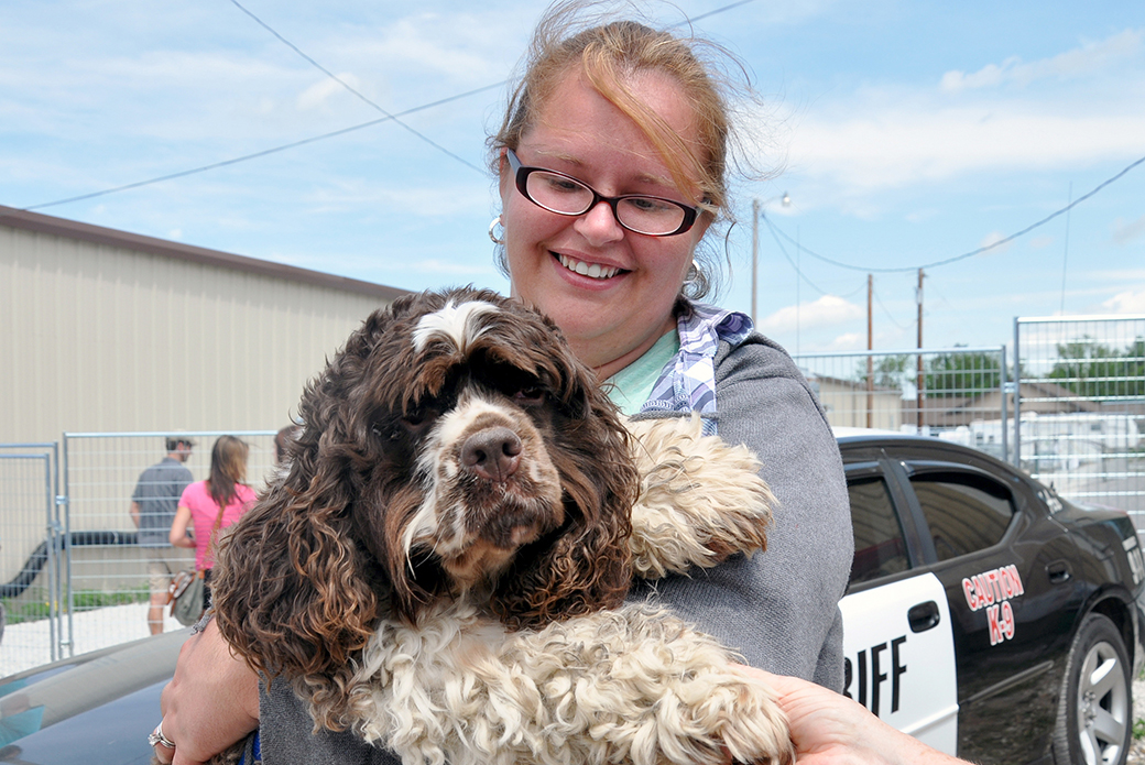 a woman reunited with her dog