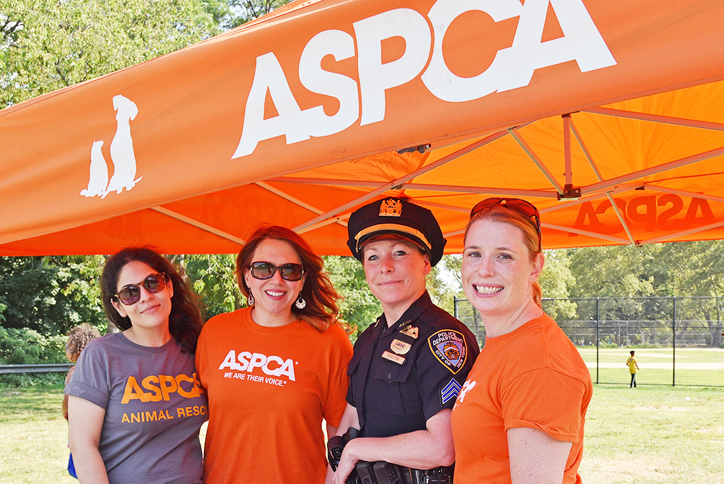The ASPCA's Isadora Peraza-Martinez, Theresa Harris, and MaryLyn Cabello with Sgt. Maria Sexton of the NYPD