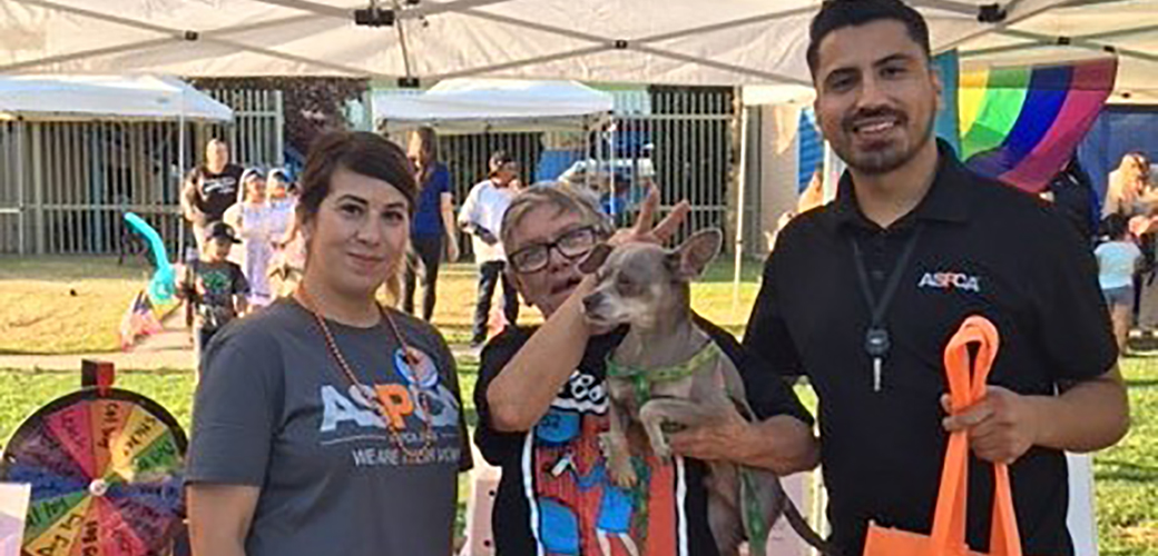 Susan Villa, Miguel Torres with Cindy Birchell and her dog
