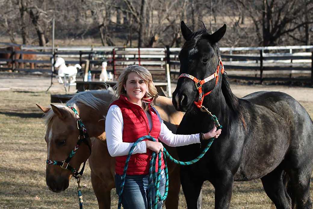 Amy with her rescued horses