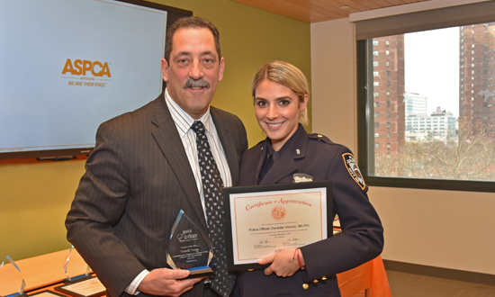 Howard presenting Police Officer Danielle Venuto with her award