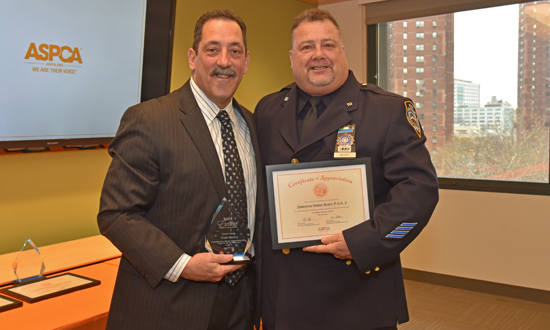 NYPD Community Affairs Officer Walter Brant accepts his award.
