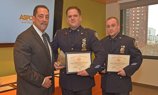 Howard poses with Detectives Matthew Edelman and Jonathan Kalman