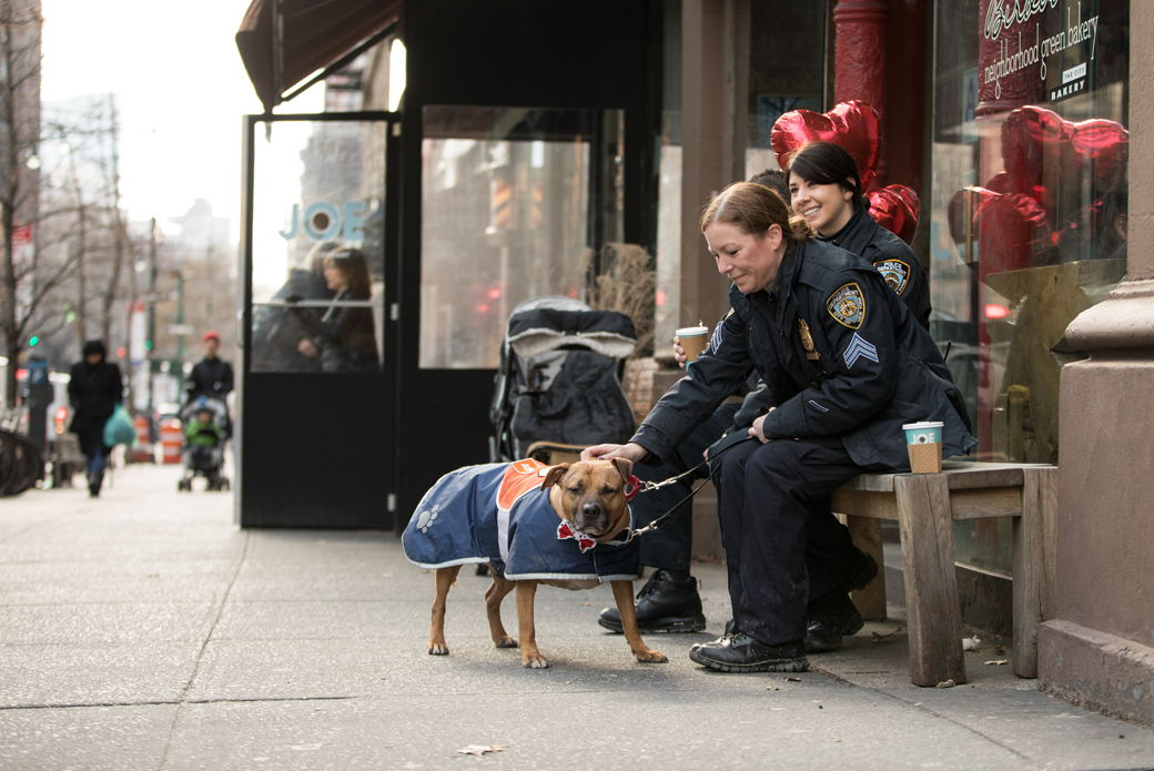 Orson outside a store with Sergeant Maria Sexton and Officer Sara Moran