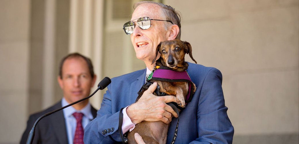 Assemblymember Quirk holding Sadie the Dachshund
