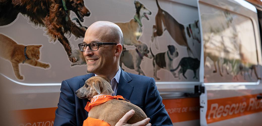 Matt Bershadker holding a puppy