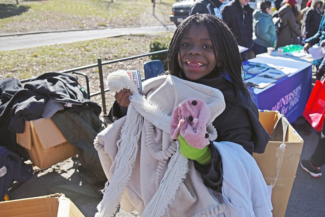Nine-year-old Kahiyah Tyler with winter wear for her family.