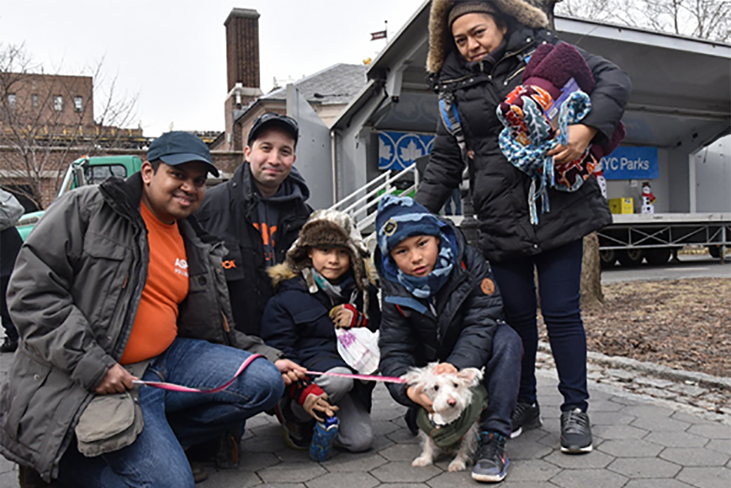ASPCA staff and volunteer with Maribel and her nephews and their dog