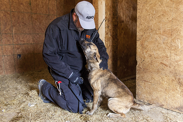 Kyle Held, FIR Responder, with puppy mill dog