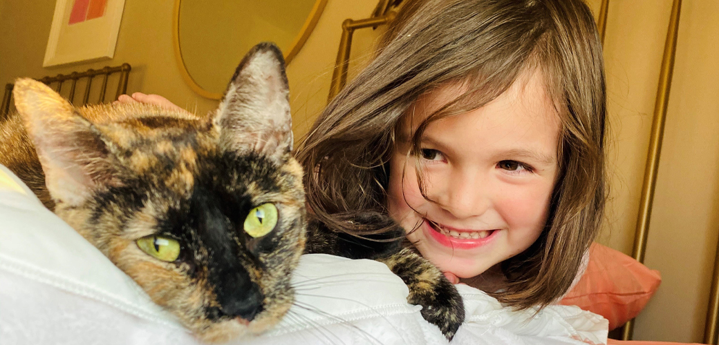 Delicata the cat with girl