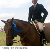 "Riding ""on the buckle"""