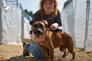 FIR team member with dog rescued from a dogfighting raid