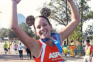 ASPCA runner in tutu with medal
