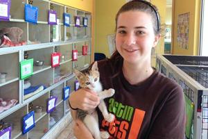 Young girl holding kitten