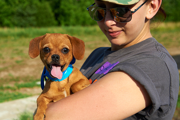 ASPCA responder holding cute puppy