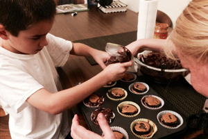 Young boy making brownies