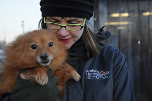 Kentucky responder holding puppy mill dog
